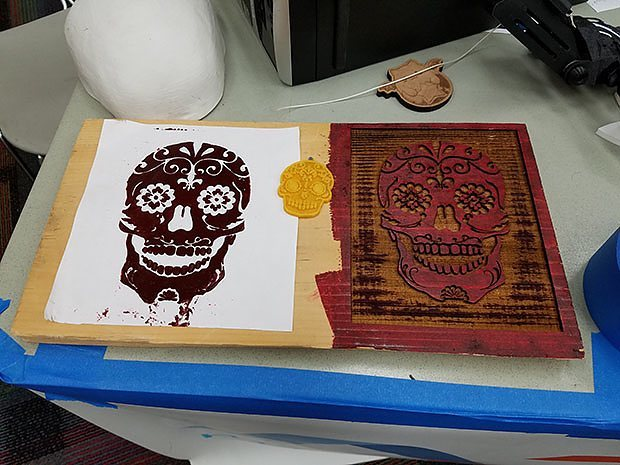 A member of the NJ Makerspace Association used a high-tech laser cutter to create a traditional plate for printing. Photo credit: Sandra Roberts